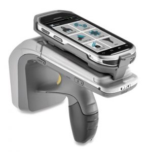 Silver hand held scanner with mobile attached