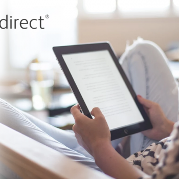 Woman Reading an eBook Using a Tablet
